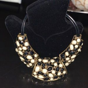 Black/white/necklace piece with gold trims